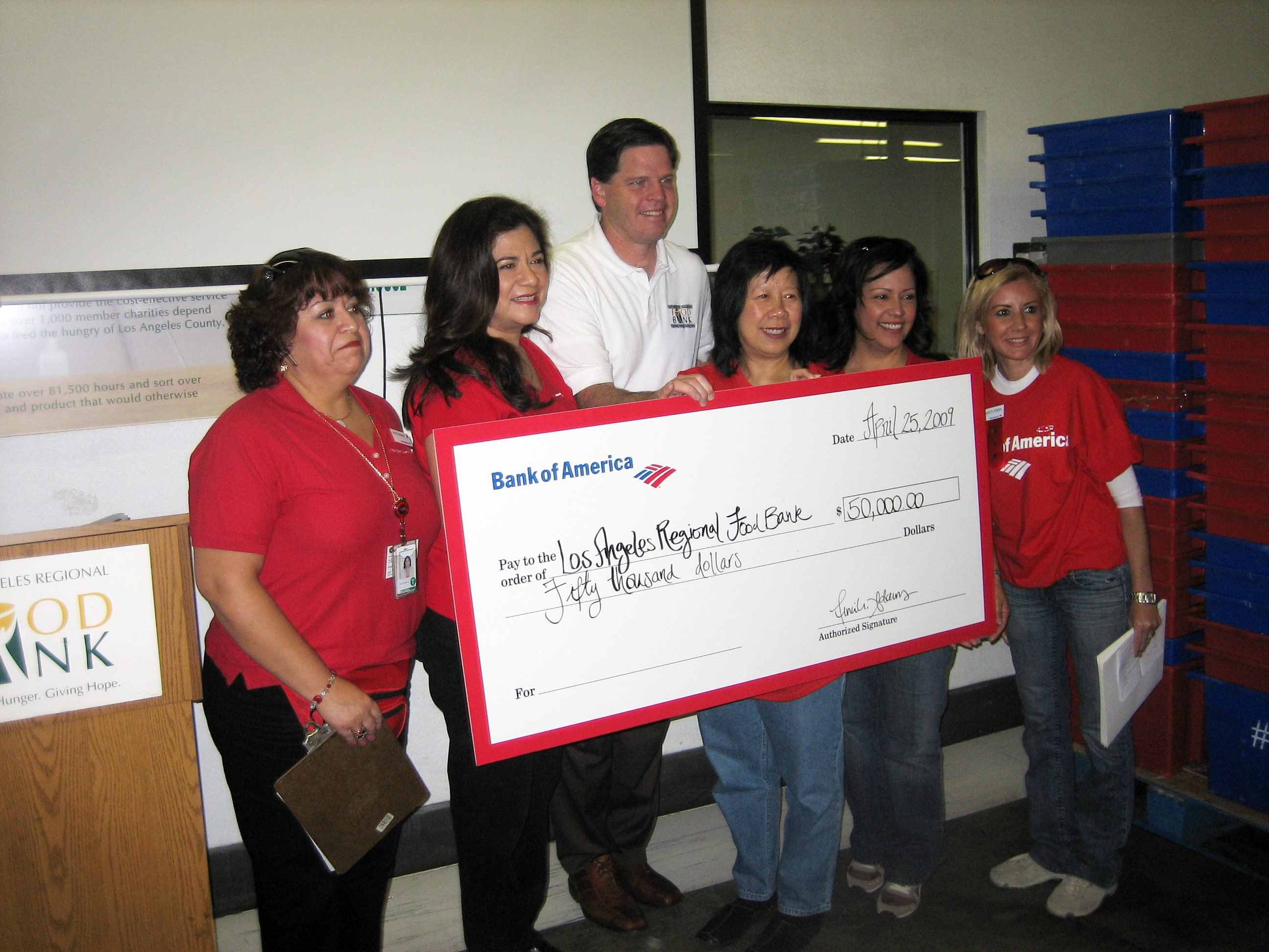 L.A. Regional Foodbank President and CEO Michael Flood receives a check for $50,000 from Bank of America.