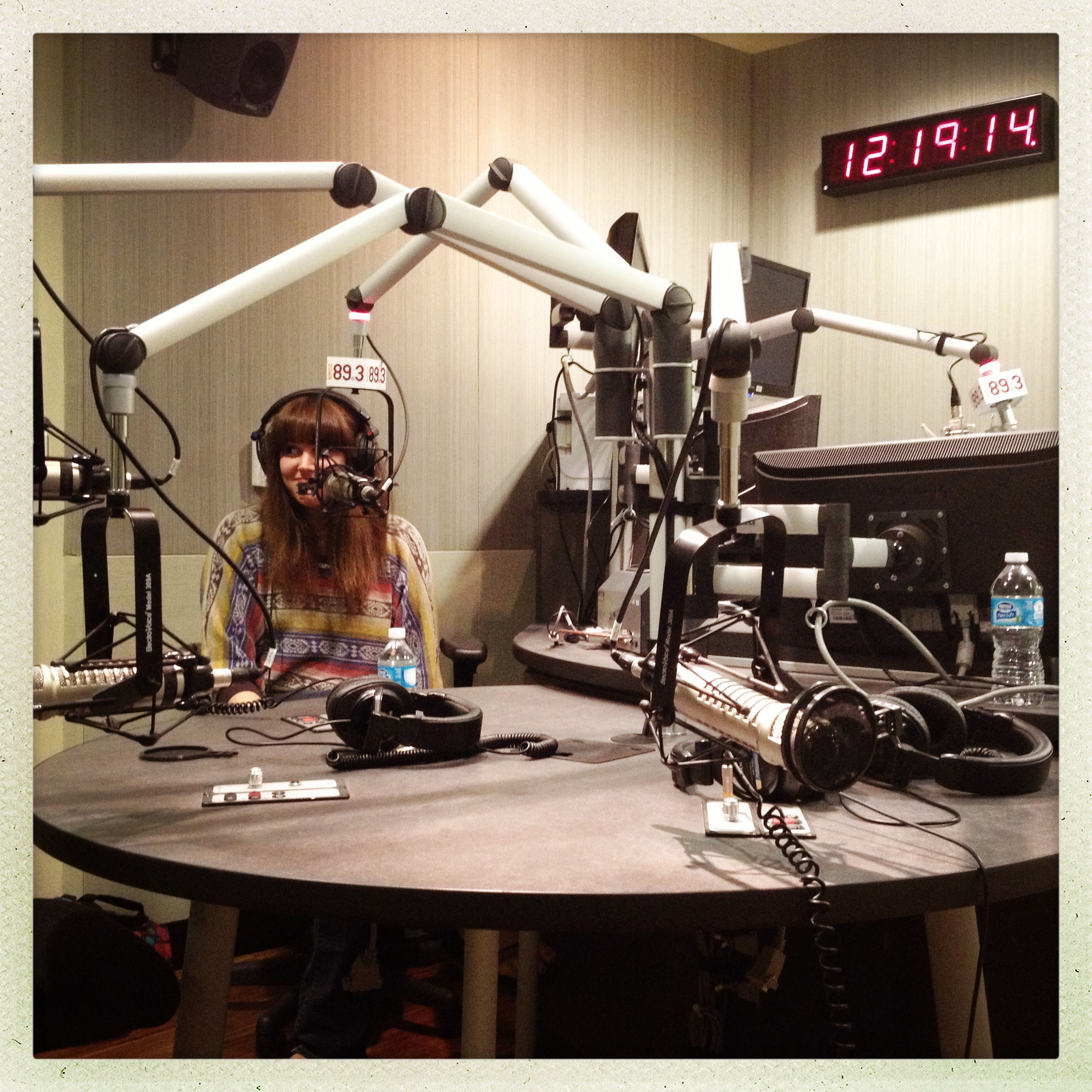 Alhambra Source Reporter Corps fellow at KPCC-FM studios.