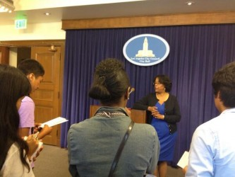 Jan Perry speaking with members of Reporter Corps South LA at City Hall.