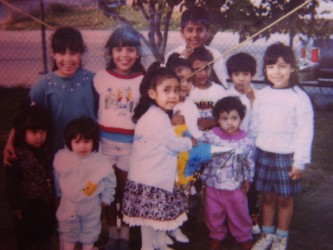 Xochil (middle) with her family in her backyard | Watts, Ca