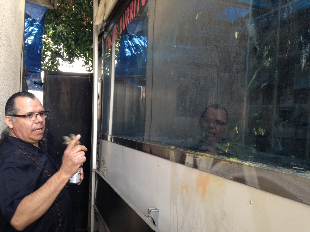 Enrique Diaz shows the truck-trailer where he once sold tacos after upgrading from a street table. He now operates a brick-and-mortar restaurant called La Carreta. | Daina Beth Solomon