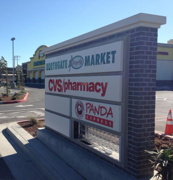 Signs advertise the businesses at the new Juanita Tate Marketplace | Wan Xu