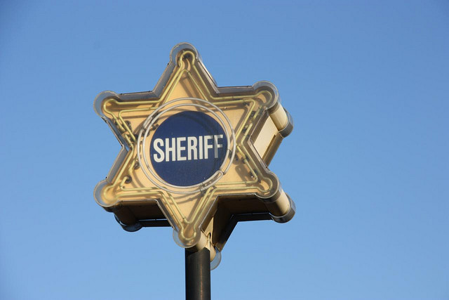 A neon sign for the LA County Sheriff's Department |  Michael Dorausch
