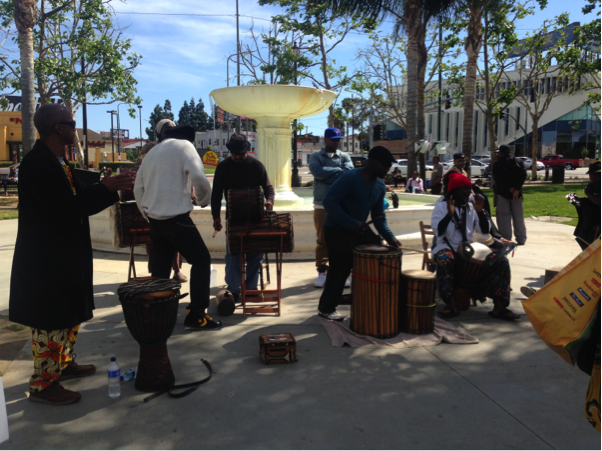 South Los Angeles residents, vendors and artists come together near the iconic white fountain in Leimert Park Village a place of commerce and community. | Jordyn Holman