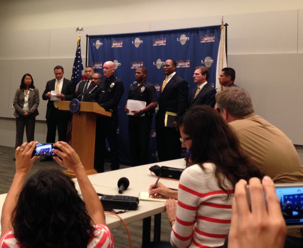 Commander Andrew Smith and others discuss the four arrests made in the killing of a USC student. | Daina Beth Solomon