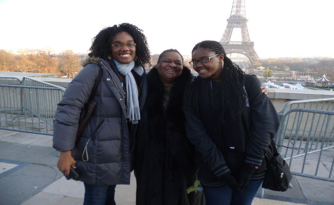 Stevenson, Leah Scurlock and I take a photo with the Eiffel Tower in the distance during the Crenshaw Choir's trip to France and Washington DC in December 2013. | Amanda Scurlock