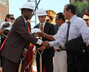 L.A. District 9 councilman Curren Price greets former mayor Antonio Villaraigosa after the groundbreaking. | Phoenix Tso/Neon Tommy