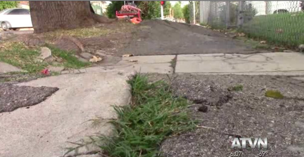 A cracked, broken sidewalk yet to be repaired in District 8. | ATVN