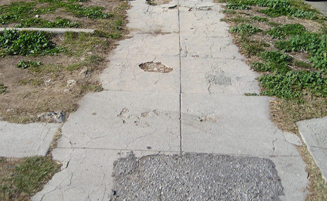 A cracked sidewalk in Los Angeles | waltarrrrr/Flickr
