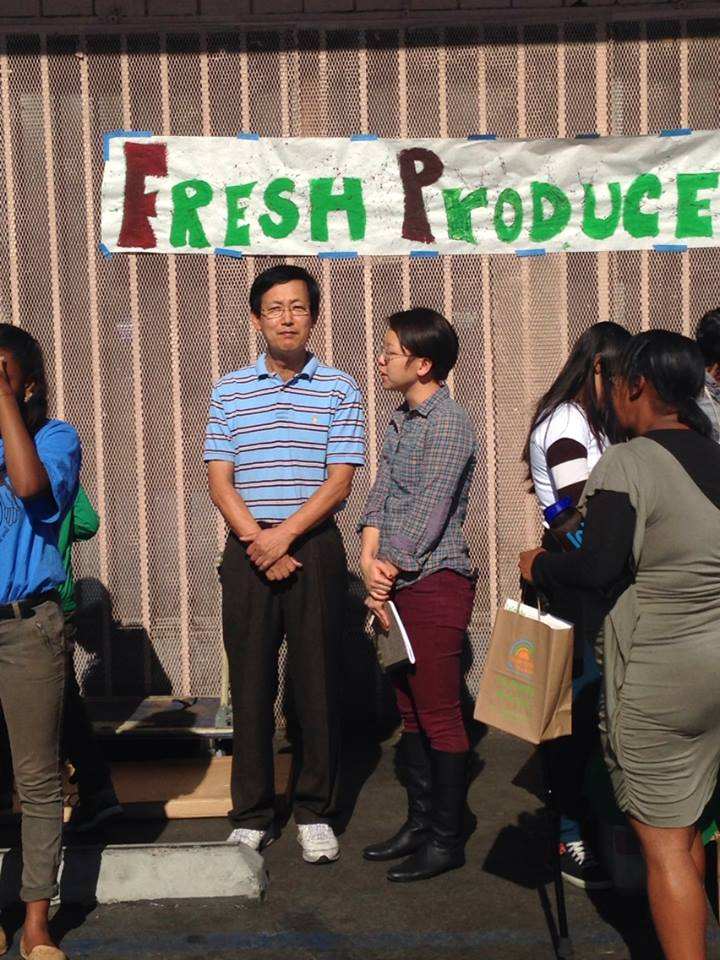 Store owner Jong Soo Park prepares to give a speech to the crowd attending the grand opening. | Jordyn Holman