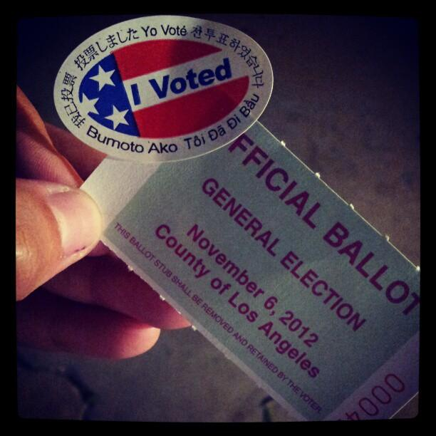 A voter in South L.A. shows off her ballot stub. |