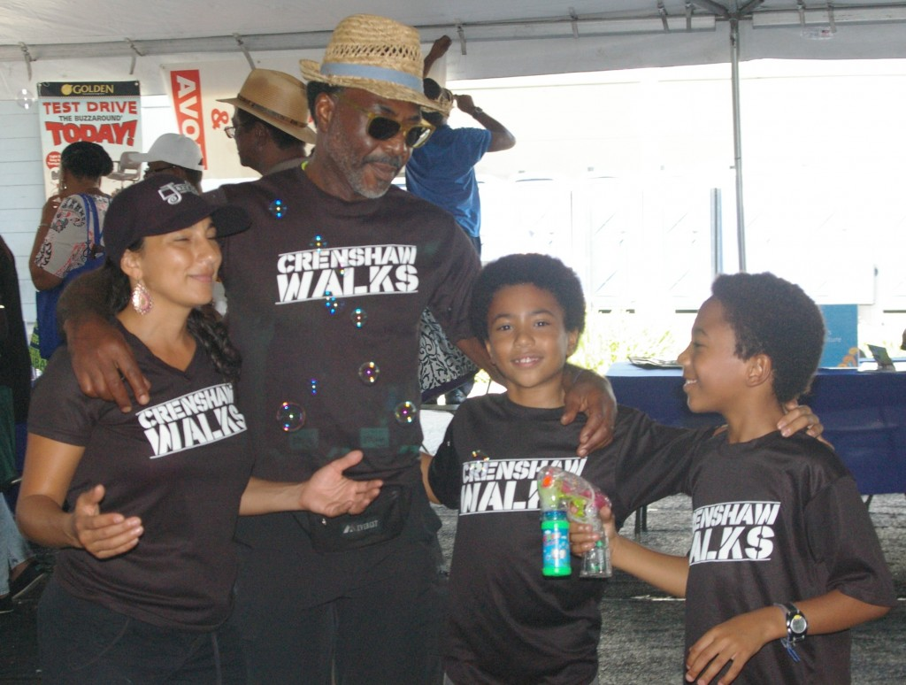 The Henry family proudly wears Crenshaw Walks t-shirts at the 2014 Taste of Soul. | Randal Henry