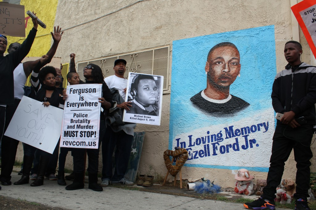 Ferguson protesters reach the site where Ezell Ford was killed last August. | Daina Beth Solomon