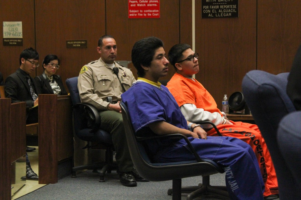 Jonathan DelCarmen and Alberto Ochoa listen to witnesses give testimony as Rose Tsai, attorney for Xinran Ji's parents, watches from the audience. | Daina Beth Solomon