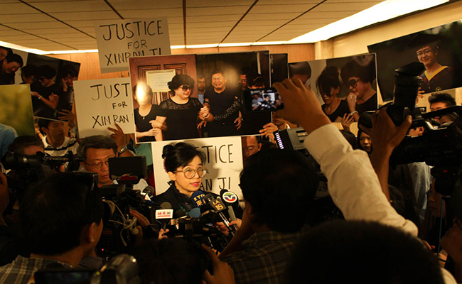 Rose Tsai, attorney for Xinran Ji's family, speaks to reporters at the court last summer.  Daina Beth Solomon