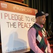 Russel Simmons urges students to take a peace pledge at Dorsey High School.   Maddy Ewles