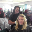 Hair stylist Aja Marie Chaff gives back to the community by cutting hair on Pamper Me Day.   Photo by Mirian Fuentes