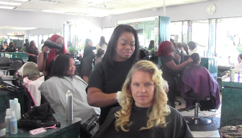 Hair stylist Aja Marie Chaff gives back to the community by cutting hair on Pamper Me Day. | Photo by Mirian Fuentes