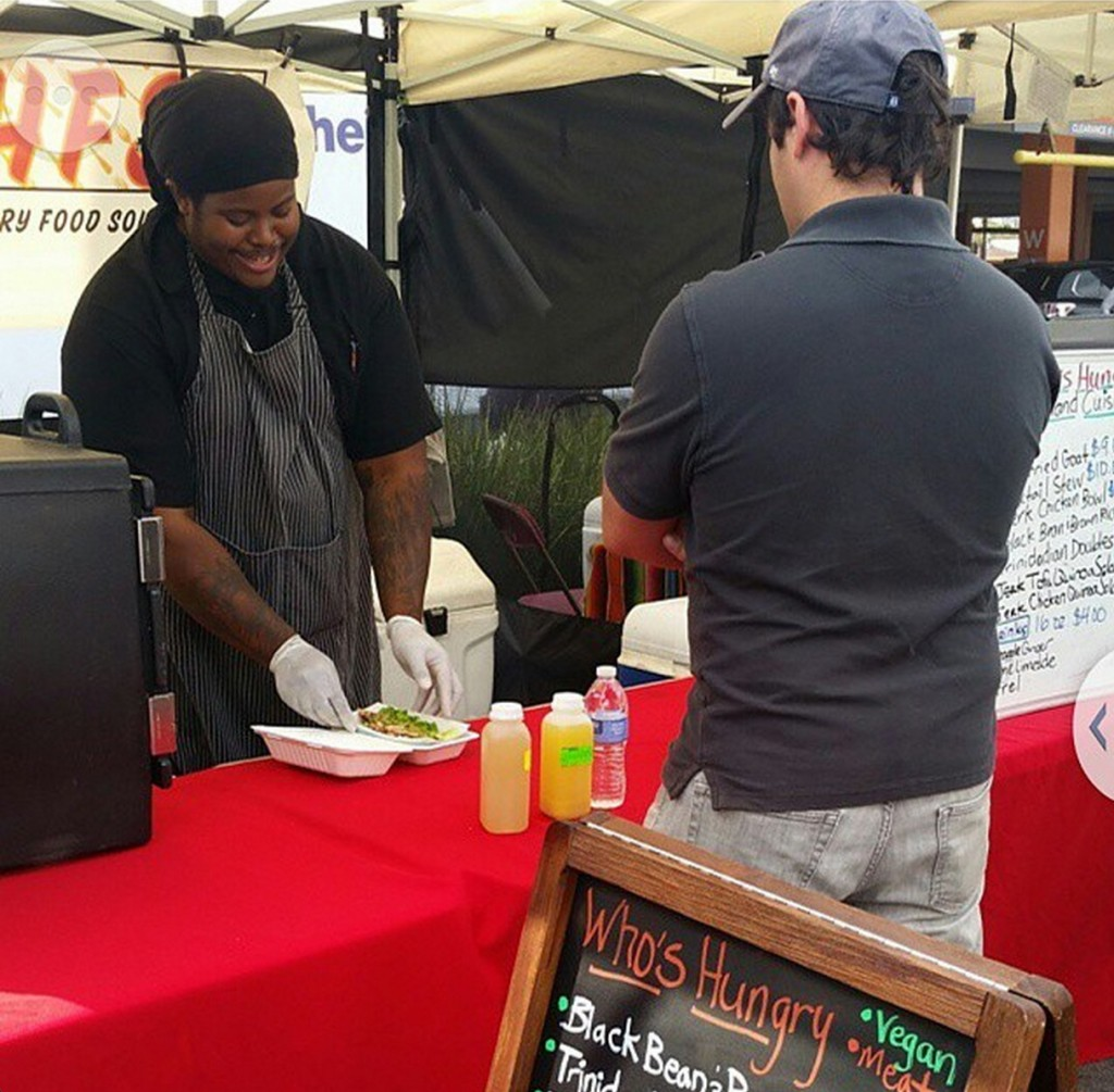 Stuart Eubanks takes his post at the farmers market. | Who's Hungry Instagram