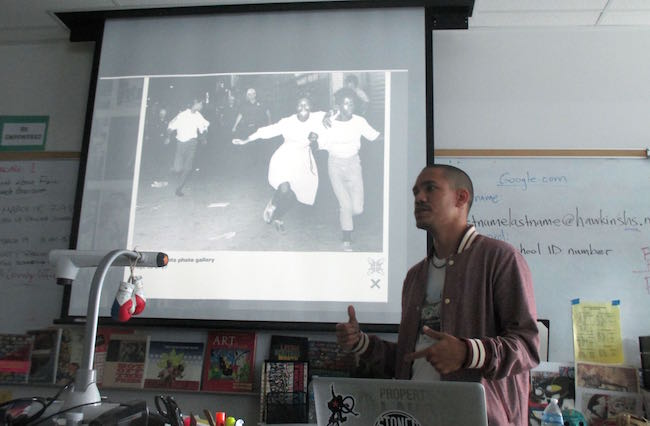 Jay Davis stands in front of his class at Augustus Hawkins High School. | Photo by Anna-Cat Brigida