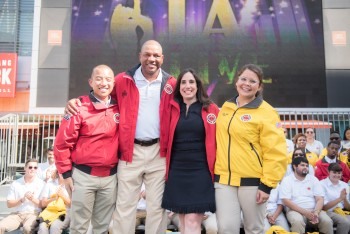L.A. Clippers Coach Doc Rivers and L.A. Clippers President of Business Operations stands with  City Year AmeriCorps members.
