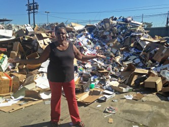 Resident Charletta Butler poses with community trash that has been brought to Active Recycling.  | Photo by Rachel Cohrs