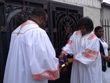 Reverends Russell Thornhill and Leslie Butke cut the ribbon officially opening the doors of the new home of the Unity Fellowship Church of Christ in South L.A.