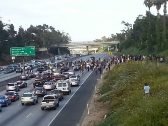 Protesters spilling onto the 10 Freeway at Crenshaw Boulevard.  Photo by Jazmin Garcia for Intersections South LA.