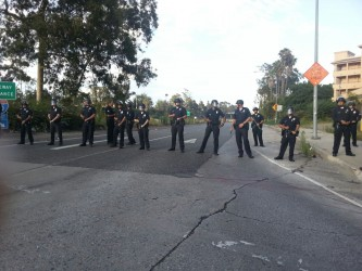 Police barricade against protesters.  Photo by Jazmin Garcia for Intersections South LA.