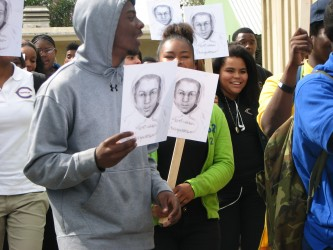 Marchers commemorating Martin Luther King's historic speech with a memorial to Trayvon Martin at Crenshaw High School.