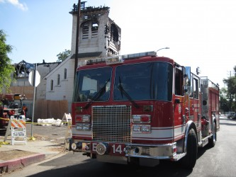 Firefighters follow up at the Church fire.