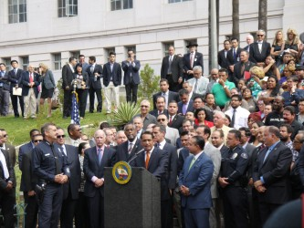Gov. Jerry Brown signs a bill that will allow undocumented immigrants receive driver's licenses. Photo by Grace Lim.