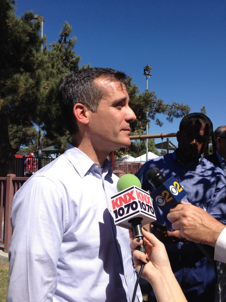 Los Angeles Mayor Eric Garcetti speaks to journalists at Powerfest South LA. Garcetti said he wants Los Angeles to register more people for health care than anywhere else in the US. Photo by Katherine Davis.