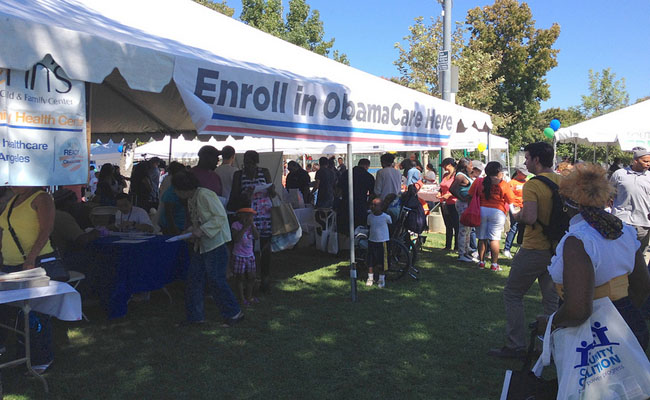 Lining up to find out about Obamacare at Powerfest South L.A. Photo by Katherine Davis.