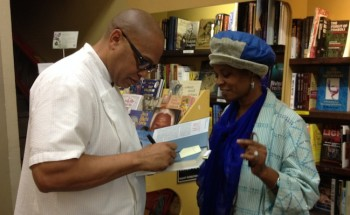 Chef Jeff signs a copy of his newest book at Eso Won Books.