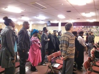 Community members observing a minute of silence remembering the late Marguerite Poindexter LaMotte at the First AME church| Photo credit: Sinduja Rangarajan