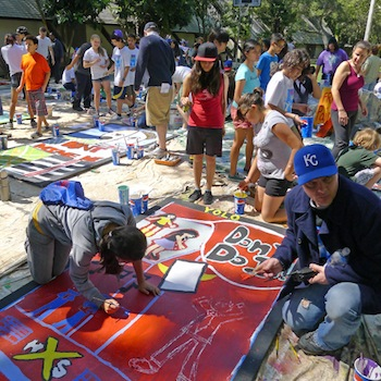 The children paint their flats on a camping trip | Photo Courtesy of Inside Out Community Arts