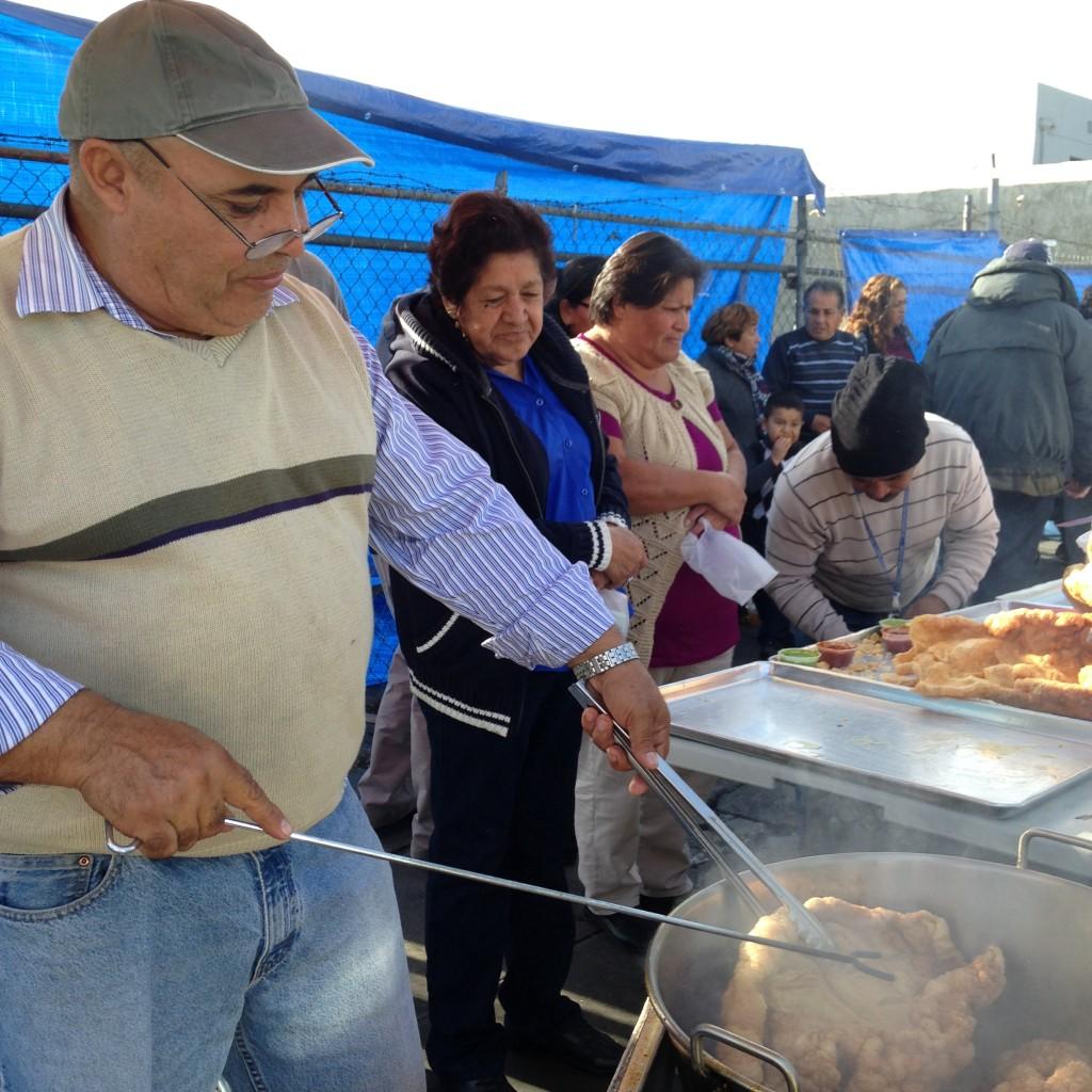 Enrique Peralta fries pork skin into chicharron at the Mercado Olympic each weekend. | Daina Beth Solomon