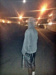 Tobi Oduguwa looks out onto the street where he said he experienced racial profiling in the area near USC. | Lensa Bogale