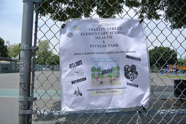 A sign advertises the weekend hours for the Trinity School park. | Joey Wong
