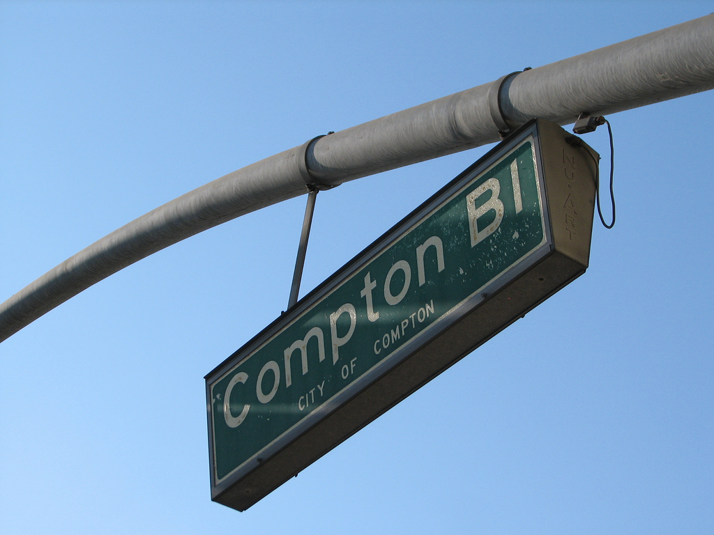 A sign for Compton Boulevard running through Compton. | Boo Reynolds / Flickr