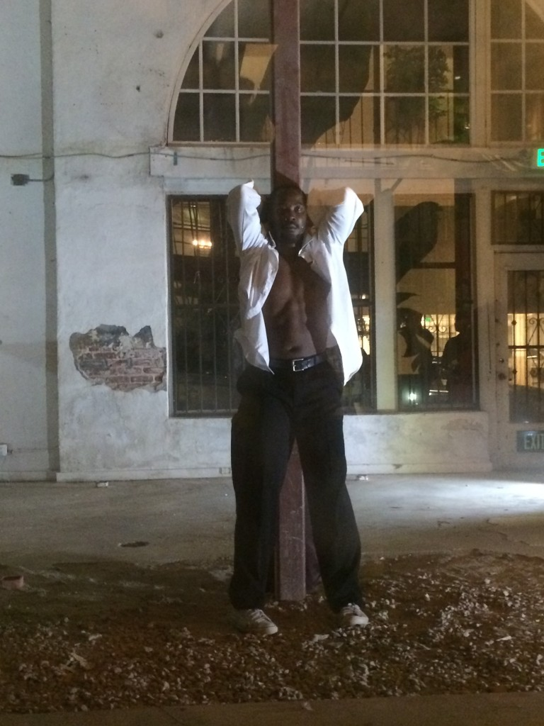 Dancer Wilfried Souly performs in the Dunbar Village's unoccupied storefront. | Christina Campodonico