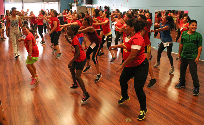 Students get some air time while jumping in a Zumba class. | Daina Beth Solomon