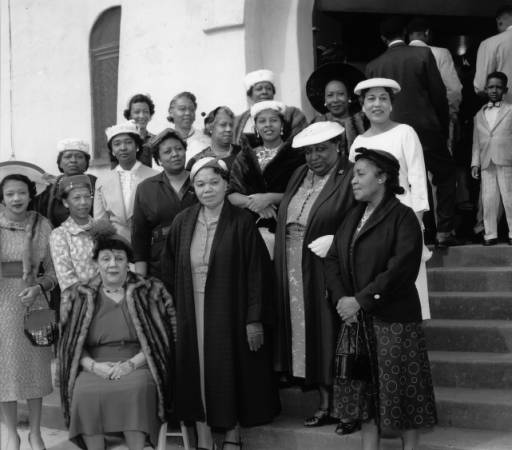 """""""Church Mothers"""" stand outside the First AME Church in South LA, circa 1960. 