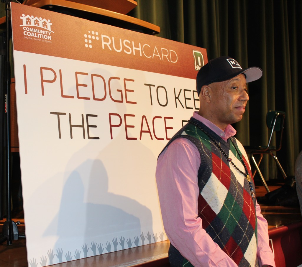 Russel Simmons urges students to take a peace pledge at Dorsey High School. | Maddy Ewles