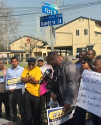 Residents rally at the corner of 92nd and Bandera Street in South L.A. | Photo by Leah Harari