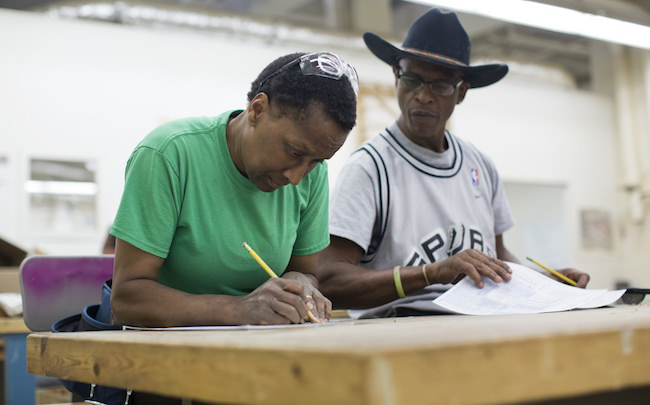 Students take a math test on the first day of a seven-week construction class at Los Angeles Trade Tech College on Monday, April 6, 2015. The class is aimed toward veterans, women and at-risk youth. | Photo by Maya Sugarman for KPCC